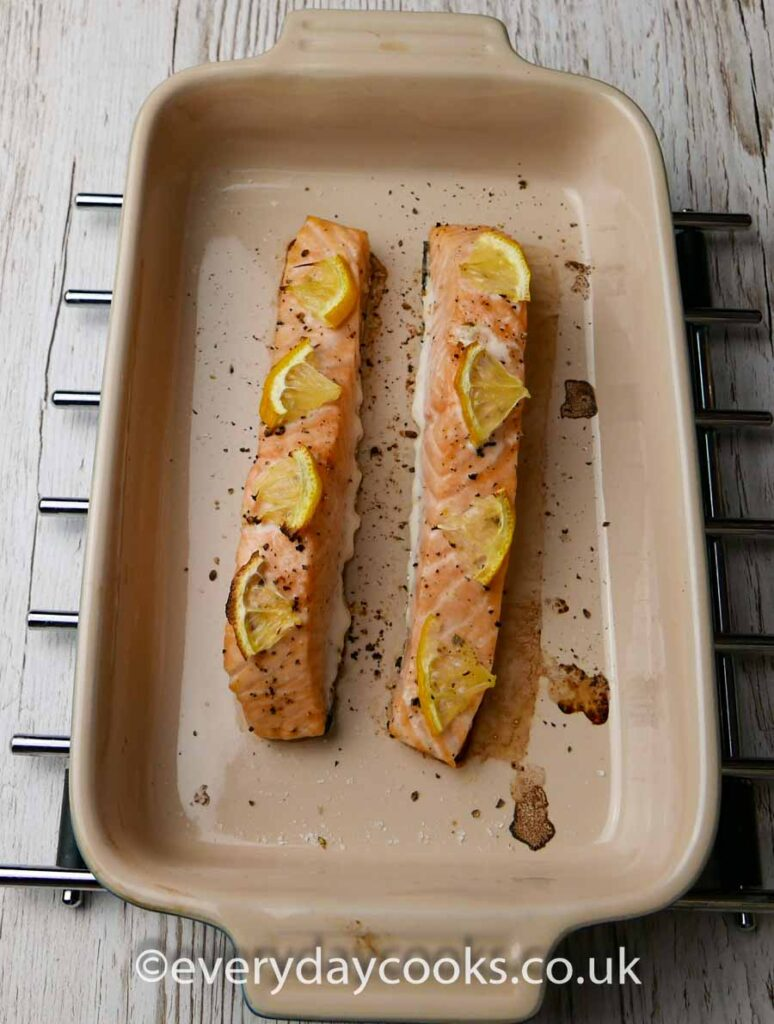 Two Baked Salmon Fillets in a gratin dish