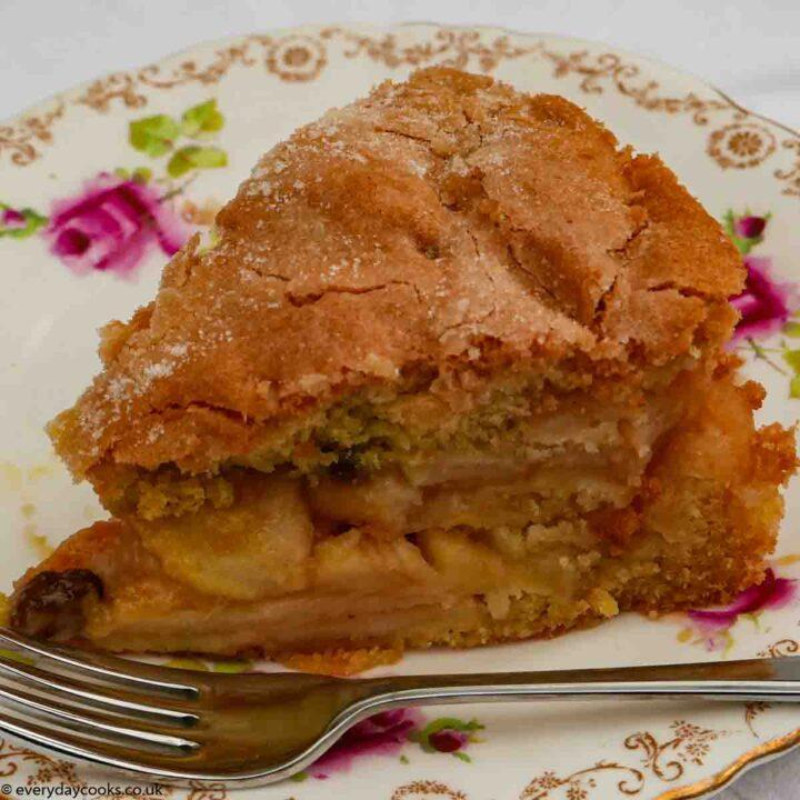 A slice of Apple Sponge Cake on a white plate
