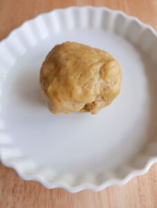 A ball of pastry in a white quiche dish