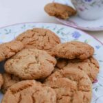 Ginger Biscuits on a plate with a cup of tea.