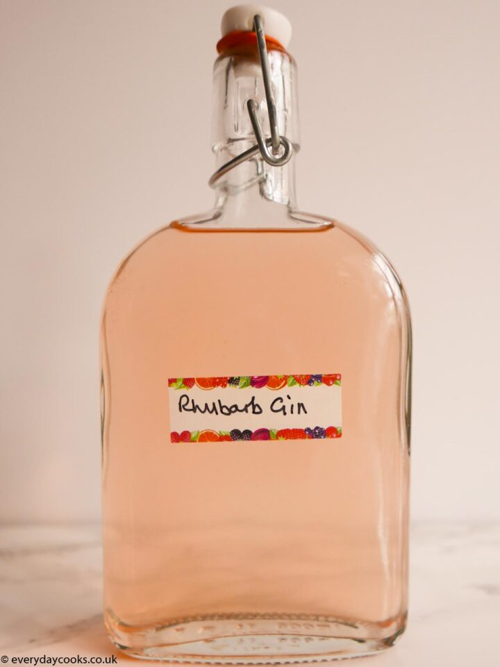 A half-litre bottle of rhubarb gin with a hand-written label