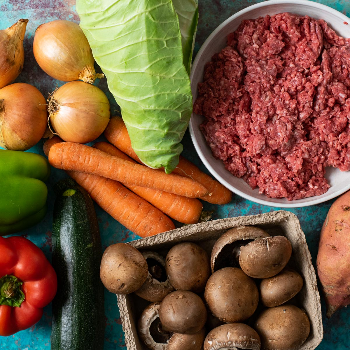 Selection of vegetables and minced beef. Ingredients for Basic Bolognese Sauce