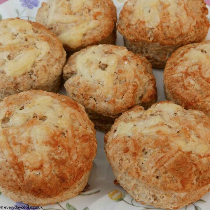 Seven cheese scones on a flowered plate
