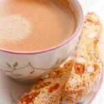 Apricot and almond biscotti with a cup of coffee.