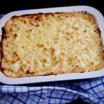 A dish of deluxe macaroni cheese, ready for the table.