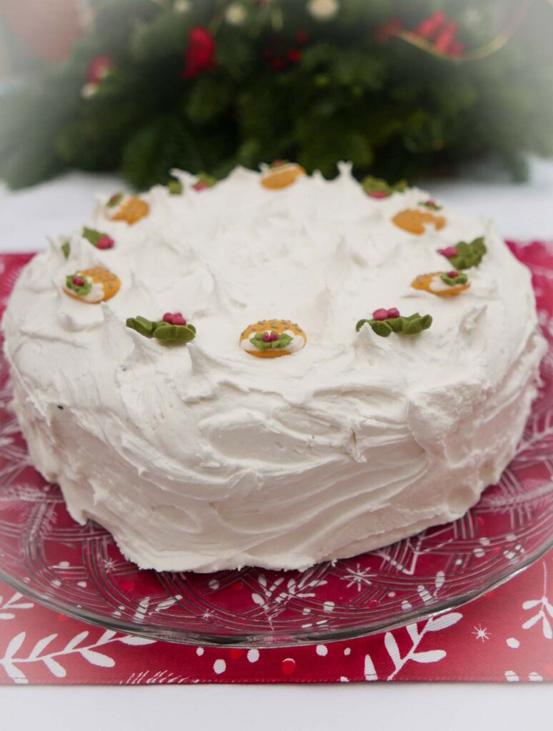 Christmas Cake with royal icing, decorated with sugarpaste holly and Christmas puddings