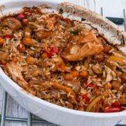 Moroccan Chicken in a white casserole dish