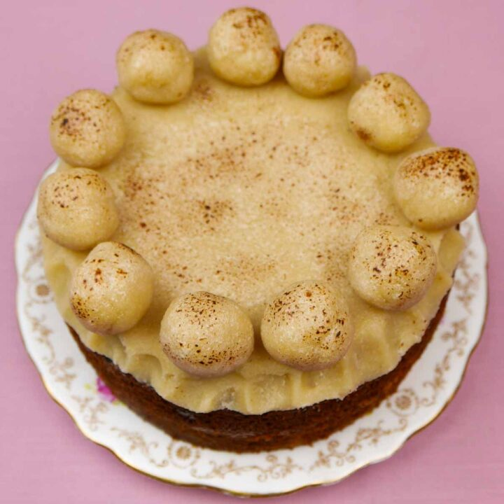 Light Simnel Cake on a patterned plate on a pinkcloth