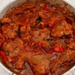 Lamb Chops in tomato sauce in a large pan