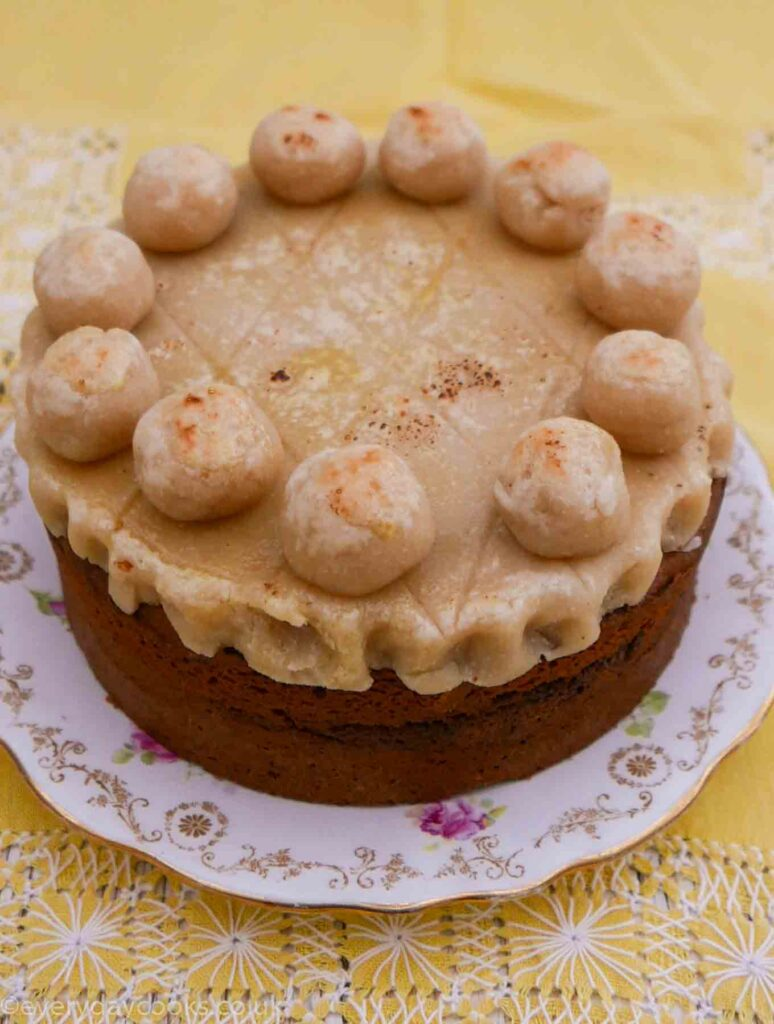 Orange Simnel Cake with a layer of marzipan and 11 marzipan balls to decorate