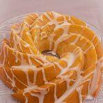 Lemon Bundt Cake with lemon drizzle icing on a glass plate