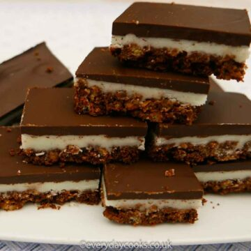 A stack of Chocolate Mint Crispies on a white plate
