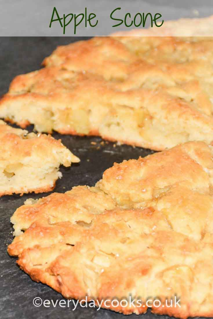 Apple scone on a slate with a slice pulled out