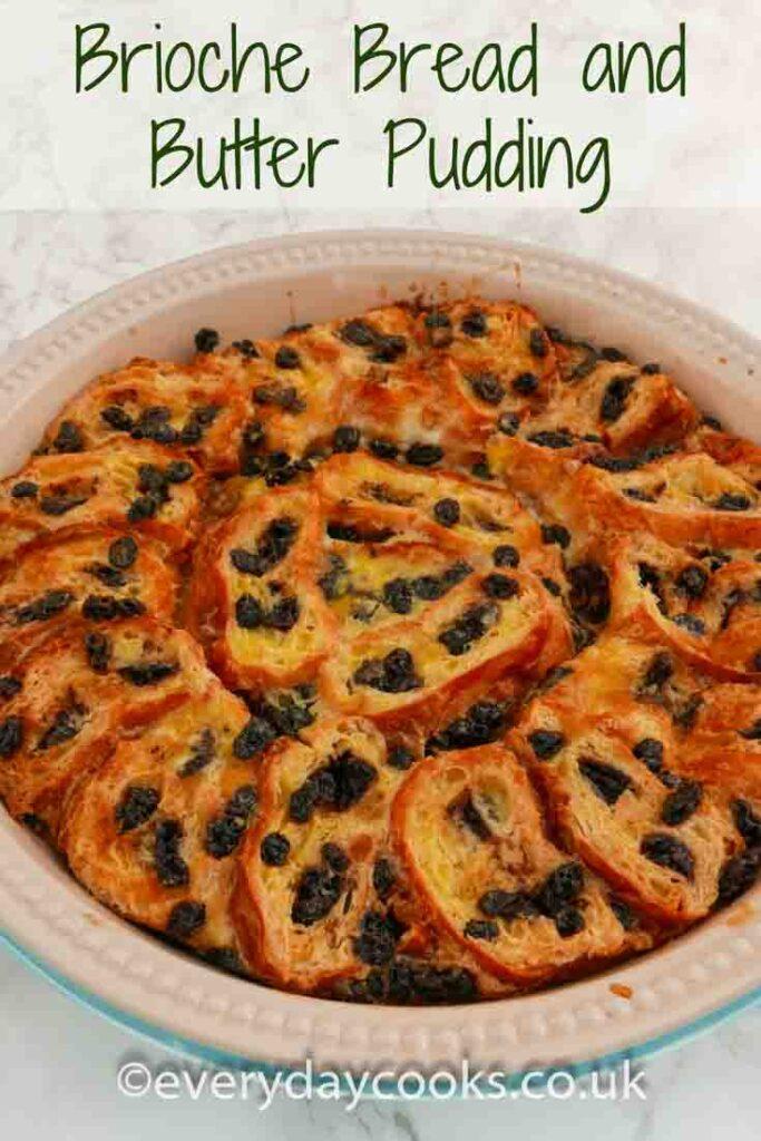 Brioche pudding. Slices of chocolate brioche with currants in a custard in a round pie dish