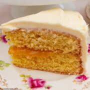 A piece of Lemon and Elderflower Cake on a flowered plate