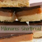 Five pieces of millionaires shortbread piled on top of each other.