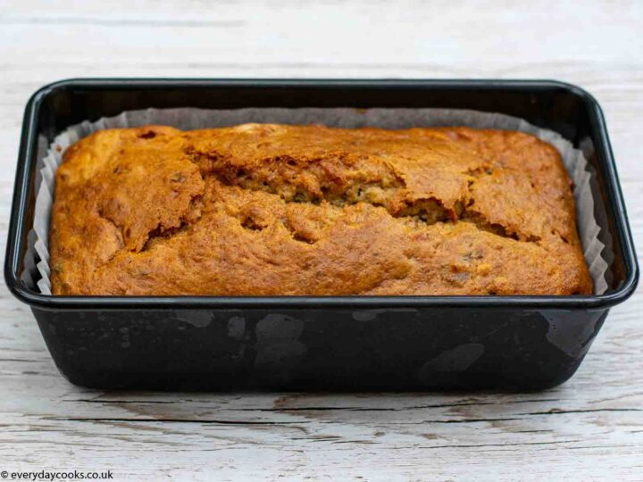 Lined loaf tin of cooked Banana Loaf cake