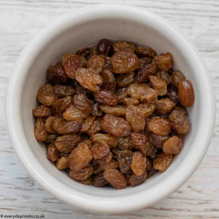 White bowl of soaked sultanas for Banana Loaf