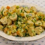 Best Potato Salad with diced cucumber and yellow pepper in an oval dish