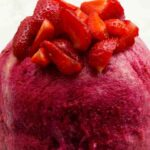 Summer Pudding with sliced strawberries on top