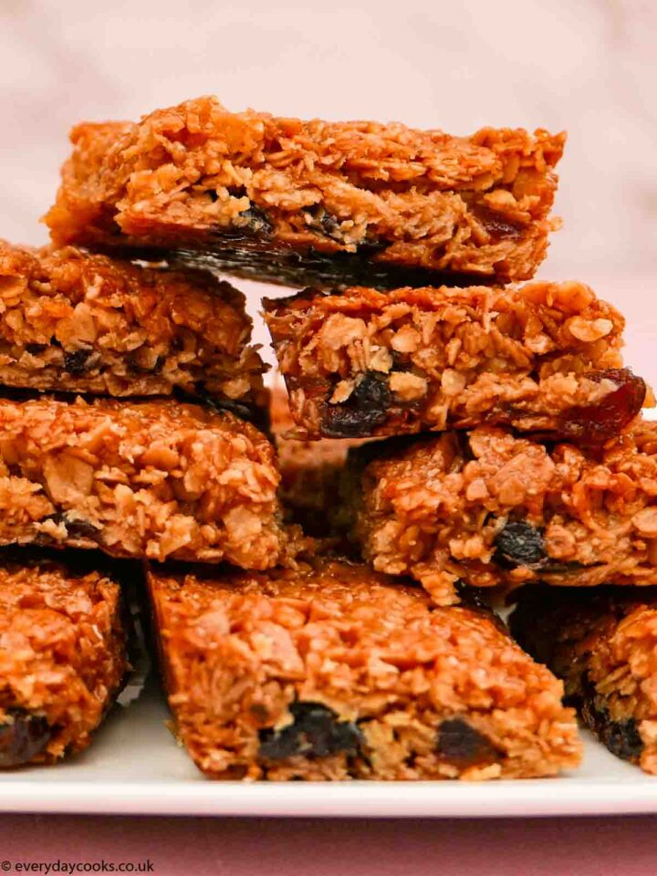 A stack of pieces of Cherry Flapjack on a white plate
