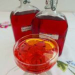 Raspberry Gin cocktail with 2 bottles of Raspberry Gin