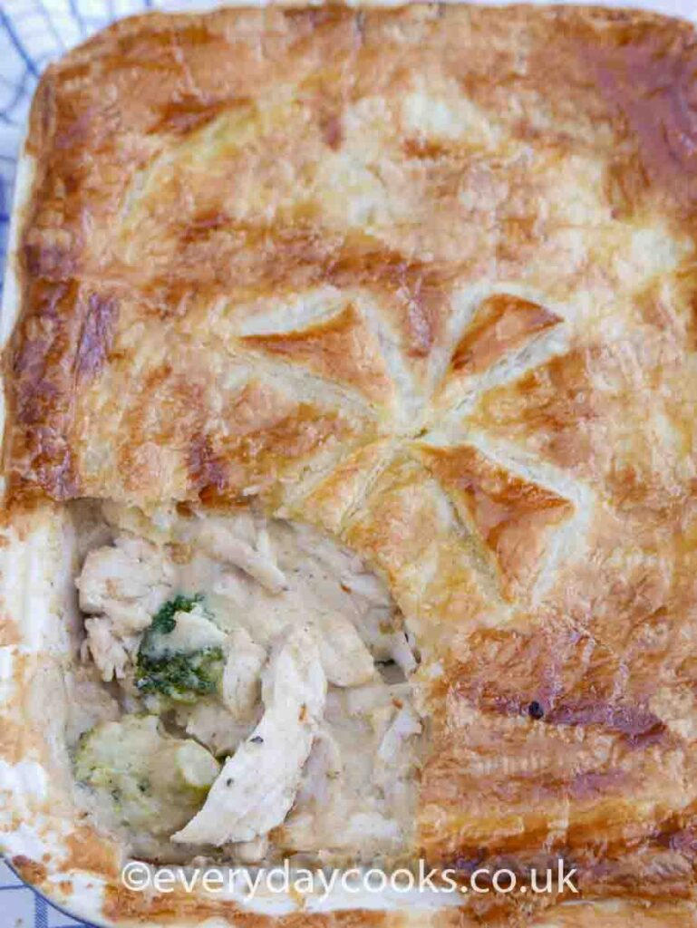 Chicken and Broccoli Pie with a slice of pastry cut out