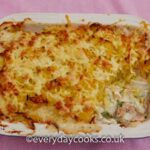 Luxury Fish Pie in a dish with a part of the filling exposed.