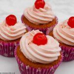 Three Triple Cherry Cupcakes on the worktop