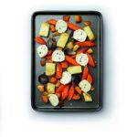 Black rectangular baking tray with vegetables