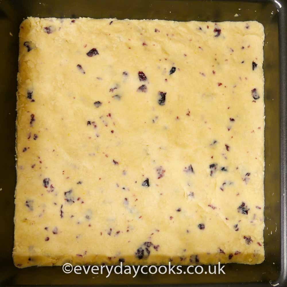 Christmas Shortbread mixture pressed into the tin