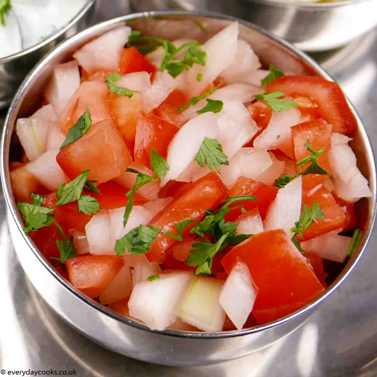 Onion and Tomato Salad in a metal bowl