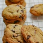Pecan Chocolate Chip Cookies on a wire cooling rack