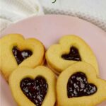 4 heart-shaped Valentine Jammy Dodgers on a pink plate