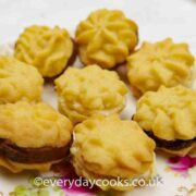 Mini Buttercream Biscuits with vanilla and chocolate filling on a plate