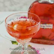 A glass of Strawberry Vodka & Tonic with the bottle