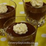 3 glasses of Easy Chocolate Mousse decorated with cream swirls