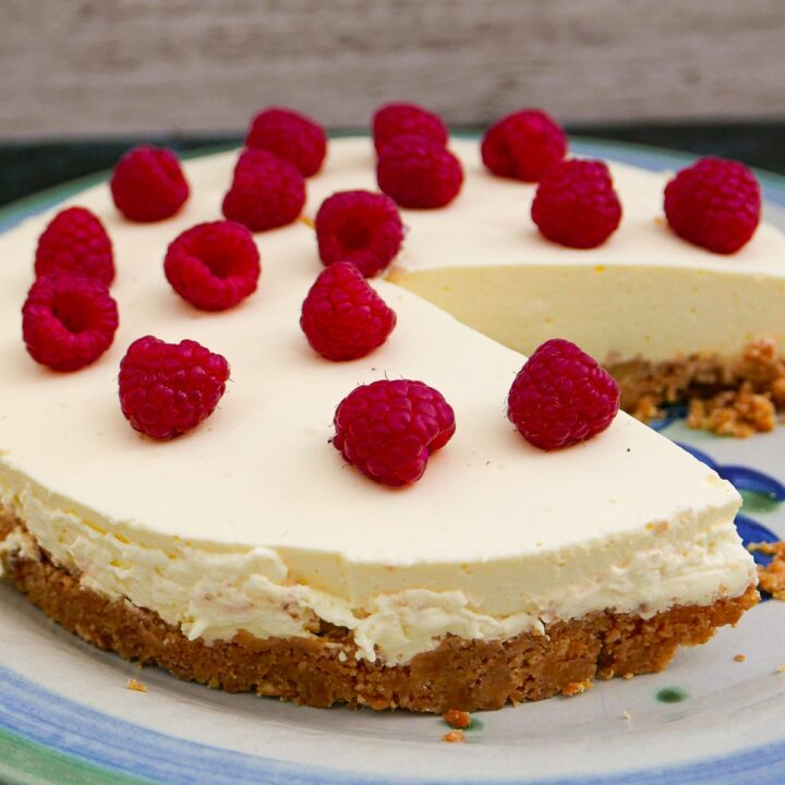Easy Lemon Cheesecake with a slice removed.
