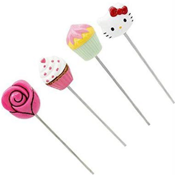 Four novelty cupcake testers