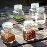 5 mini spice jars with clip lids containing herbs and spices