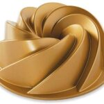Fluted gold-coloured round cake tin
