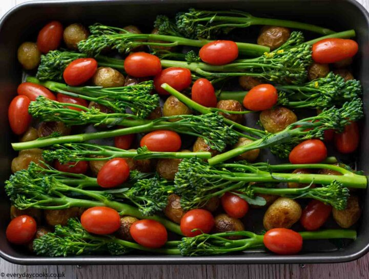 Green veg and tomatoes ready for roasting for Easy Cod Traybake