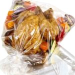 Roasting bag containing a chicken and vegetables