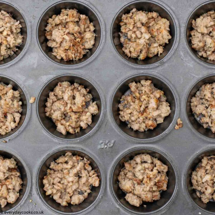 Sausage meat in black muffin tin for Savoury Muffins