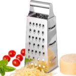 Cheese grater with cheese and tomatoes