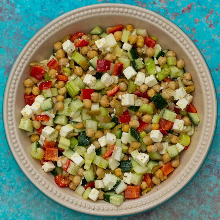 Feta Chickpea Salad in a bowl on a blue background
